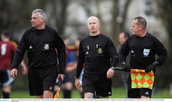 25 February 2016; Referee Marc Barry makes his way off the field after the game with linesmen Ken Hennesey and John Lenihan. Collingwood Cup Semi-Final, University of Limerick v Dublin University Association Football Club. The Farm, UCC, Cork. Picture credit: Eóin Noonan / SPORTSFILE