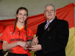 7 March 2016; Caitl'n Kennedy, John The Baptist CS, Limerick, is presented with the player of the match award by Connacht LGFA President Liam Costigan. Lidl All Ireland Senior B Post Primary Schools Championship Final. Holy Rosary College Mountbellew, Galway, v John The Baptist CS, Limerick. Gort GAA, Gort, Co. Galway. Picture credit: Piaras î M'dheach / SPORTSFILE