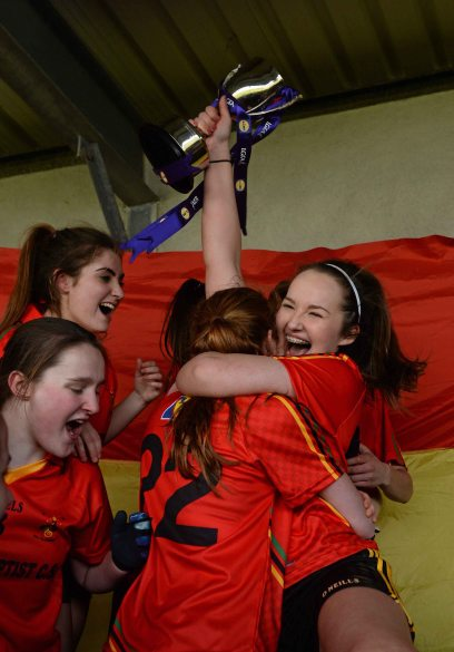 7 March 2016; John The Baptist CS captain Eimear Daly and her team-mates celebrate with the cup after the game. Lidl All Ireland Senior B Post Primary Schools Championship Final. Holy Rosary College Mountbellew, Galway, v John The Baptist CS, Limerick. Gort GAA, Gort, Co. Galway. Picture credit: Piaras î M'dheach / SPORTSFILE *** NO REPRODUCTION FEE ***