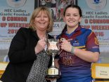 12 March 2016; University of Limerick captain Eva O'Dea is presented with the Lynch Cup by Marie Hickey, President, Ladies Gaelic Football Association. Lynch Cup Final 2016, University of Limerick v Dublin Institute of Technology. John Mitchels GAA Club, Tralee, Co. Kerry. Picture credit: Brendan Moran / SPORTSFILE