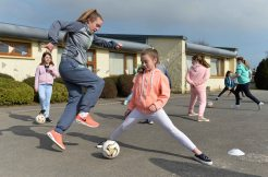 16 March 2016; Sophie Cribben, 6th class, with Republic of Ireland senior womenÕs team player Claire OÕRiordan, playing with Wexford Youths FC, from Newcastlewest Co. Limerick, during a coaching session. The Republic of Ireland players delivered over Û1,000 worth of sports equipment to Parteen National School, Co. Clare, courtesy of Continental Tyres, proud supporters of womenÕs soccer in Ireland. The school won a recent Today FM radio competition and the pupils received the new sports equipment and a special Continental Tyres training session at their school with the Irish womenÕs soccer players. Parteen National School, Parteen, Co. Clare. Picture credit: Diarmuid Greene / SPORTSFILE