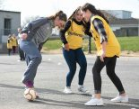 16 March 2016; Parteen NS girls 6th class students Lorna Tucker and Ellen Walters during a coaching session with Republic of Ireland U19's player Aislinn Meaney, playing with Galway WFC, from Co. Clare. The Republic of Ireland players delivered over Û1,000 worth of sports equipment to Parteen National School, Co. Clare, courtesy of Continental Tyres, proud supporters of womenÕs soccer in Ireland. The school won a recent Today FM radio competition and the pupils received the new sports equipment and a special Continental Tyres training session at their school with the Irish womenÕs soccer players. Parteen National School, Parteen, Co. Clare. Picture credit: Diarmuid Greene / SPORTSFILE