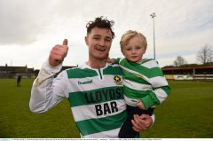 10 April 2016; Sheriff YC captain Paul Murphy celebrates with his three year old son Jade Murphy after the game. FAI Junior Cup Semi-Final, Sheriff YC v Janesboro FC. Tolka Rovers Complex, Griffith Avenue, Dublin. Picture credit: Paul Mohan / SPORTSFILE