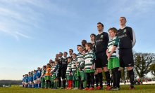 20 April 2016; St. Peters FC and Pike Rovers players stand for the National Anthem. The Final will take place at the Aviva Stadium on the 14th May. #RoadToAviva. FAI Junior Cup Semi-Final Replay in association with Aviva and Umbro, St. Peters FC v Pike Rovers. Leah Victoria Park, Tullamore, Offaly. Picture credit: Matt Browne / SPORTSFILE